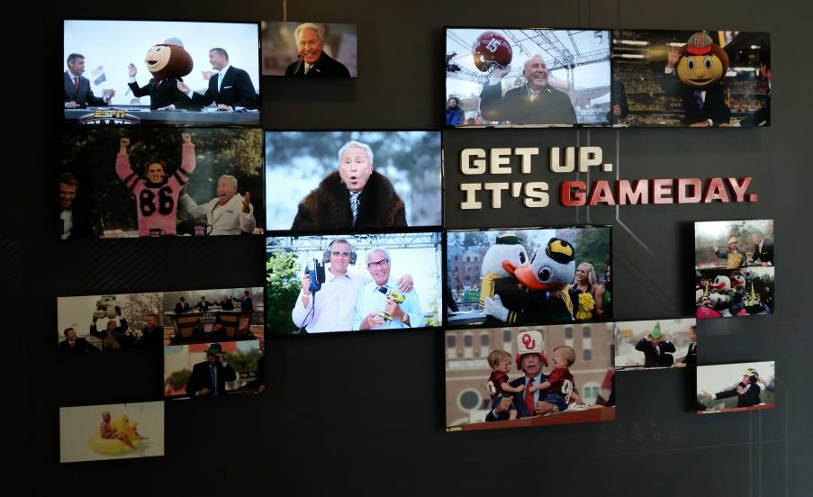 The Corso wall honors ESPN football analyst Lee Corso, a founding member of ESPN's College GameDay team. A matrix of five video wall monitors displays photos and graphics in a tribute to Corso.