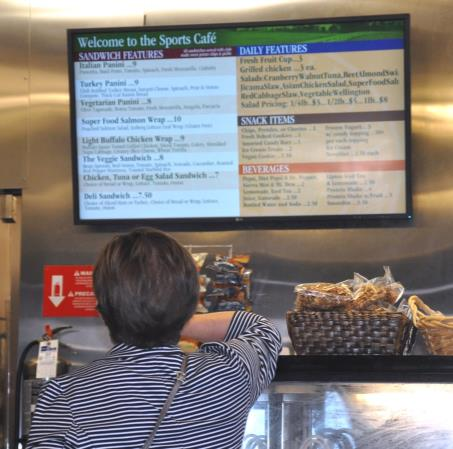 Electronic menus at the Sports Café in New Albany Country Club display daily selections.