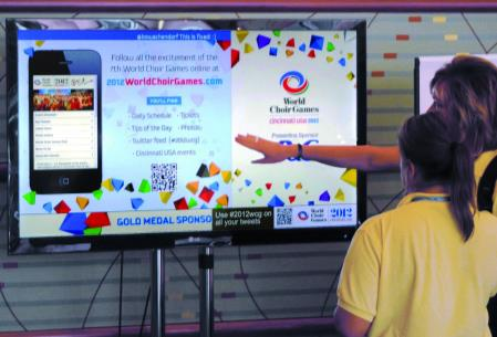 VitalSigns displays competition schedules at the World Choir Games in Cincinnati.